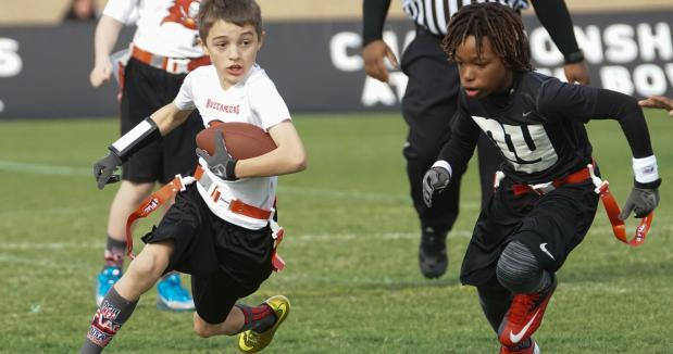 diverse kids playing flag football