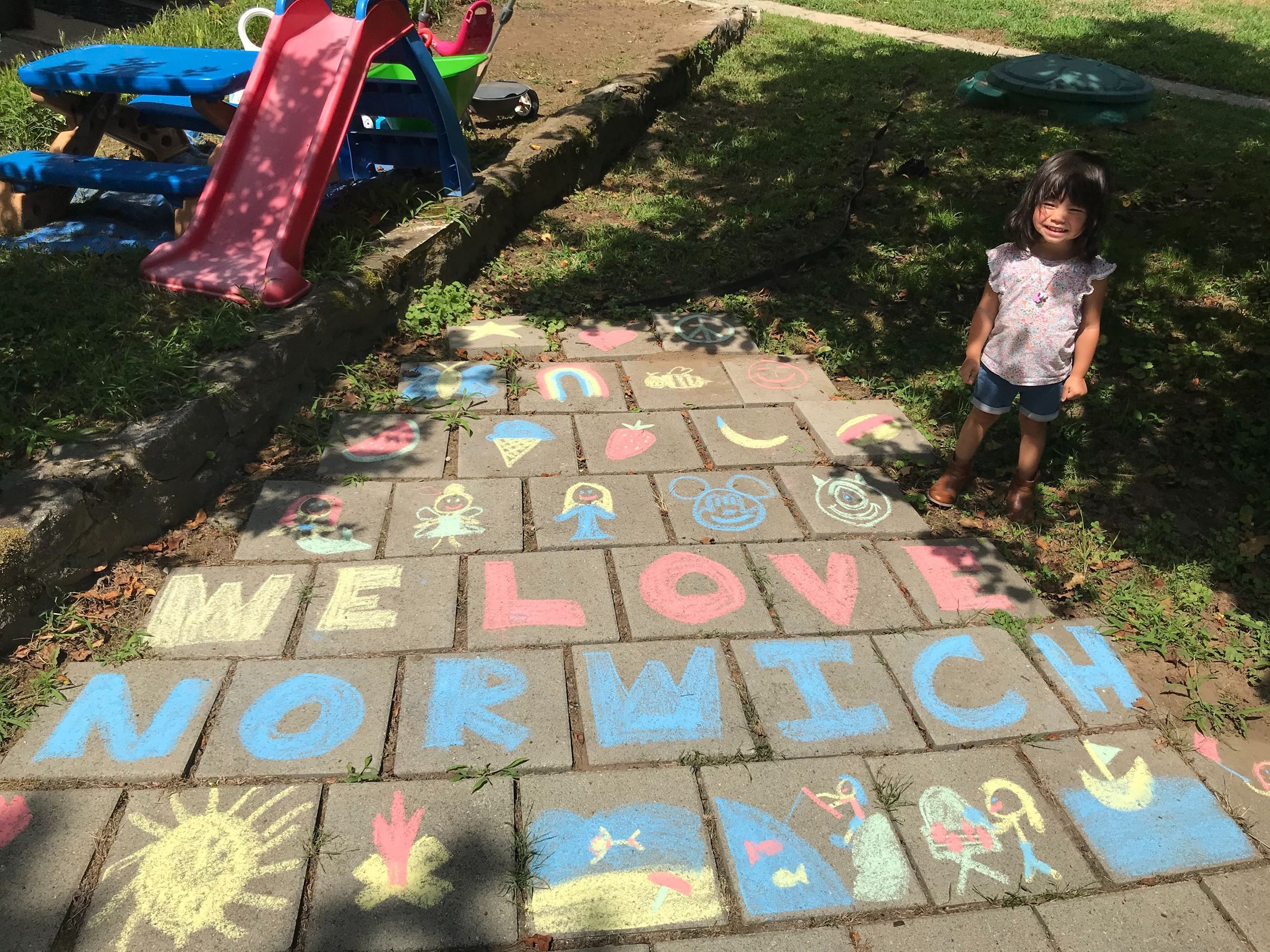Picture of kids chalk art that says WE LOVE NORWICH